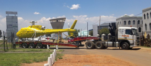 lowbed trailer transporting helicopter